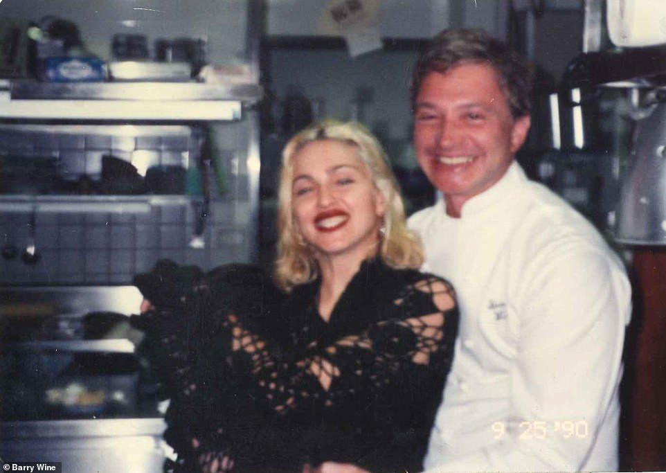 18536854-7475187-Barry_Wine_poses_with_Madonna_in_the_kitchen_of_the_Quilted_Gira-a-3_1569190656740.jpg